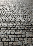 Cobbled road on industrial site Royalty Free Stock Photo