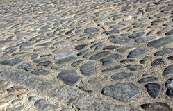 Cobbled road. Old part of big city Stock Images