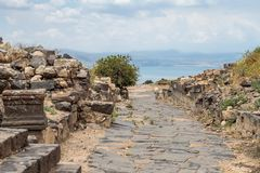 Cobbled road in the ruins of the Greek - Roman city of the 3rd century BC - the 8th century AD Hippus - Susita on the Golan Height. S near the Sea of Galilee royalty free stock image