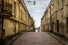 Cobbled road to the bay. Vyborg. Russia. Old streets of Vyborg. Cobbled street leading to the bay of the Baltic Sea Stock Photo