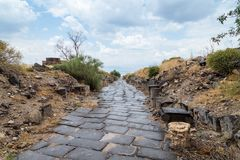 Cobbled road to the ruins of the Greek - Roman city of the 3rd century BC - the 8th century AD Hippus - Susita on the Golan Height. S near the Sea of Galilee royalty free stock images