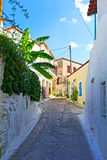 Cobbled road. View of a cobbled road at the island of Poros, Greece Royalty Free Stock Images