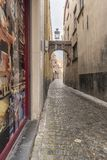 Cobbled Side street Alley with arch off Steenstraat Bruges. 