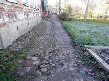 Cobbled sidewalk stock images