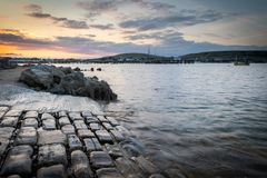 Cobbled slipway at sunset Stock Images