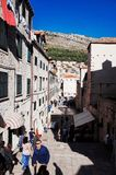 Cobbled steps and outdoor restaurants leading down to Placa Promenade royalty free stock images