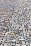 Cobbled or stone paved road creating a geometric pattern from th Royalty Free Stock Photos
