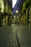 Cobbled street. By night with steet lamp and balcony stock photography