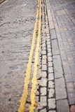 Cobbled Street. Double Yellow Old Cobble Street stock photos