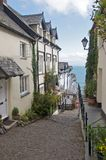 Cobbled Street Clovelly. Steep cobbled street with pretty cottages in Clovelly Cornwall stock image