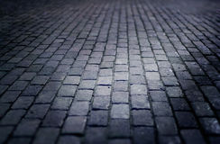 Cobbled street floor tile old brick style at night. Soft focus stock photo