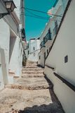 Cobbled street in frigiliana malaga spain royalty free stock photos