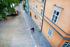 Cobbled street in historical center of city Royalty Free Stock Photo