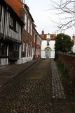 A cobbled street lined with houses. stock images
