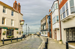 Cobbled Street lined with Renovated Buildings Stock Photo