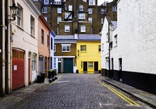 Cobbled street in London. Cobbled street and colorful brick houses in London, England, UK stock image