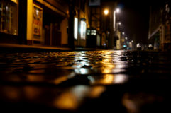 Cobbled street night B. Old wet cobbled street in a town at night after rain royalty free stock photos