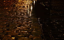 Cobbled street night rain Stock Images
