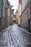 Cobbled street in old city at daytime Stock Photos