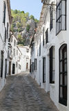 Cobbled street pavement. With white houses on the sides to see the solid background of Grazalema in the Spanish province of Cadiz Royalty Free Stock Images