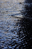 Cobbled street after rain Royalty Free Stock Photos