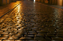 A cobbled street in the rain royalty free stock photos