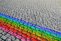 Cobbled street with rainbow stock images