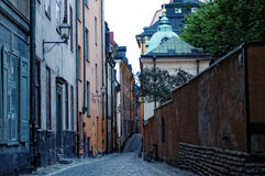 Cobbled street in Stockholm city. Old cobbled street receding into distance, Stockholm city, Sweden royalty free stock images