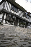 Cobbled street tudor house historic rye uk. Low angles view of cobbled streets and anicent tudor half timber houses of historic rye in sussex england Stock Photo