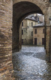 Cobbled street and tunnel on a cloudy day Royalty Free Stock Photography