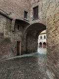 Cobbled street and tunnel on a rainy day 2 Stock Photos