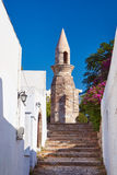 Cobbled street and the Turkish minaret Royalty Free Stock Photo