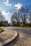 Cobbled street winds through old town Royalty Free Stock Images