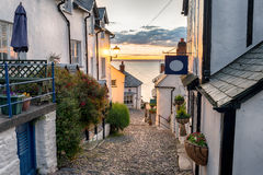 Cobbled Streets. Narrow cobbled streets lined with cottages on a steep hill at Clovelly on the Devon coast stock photography