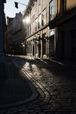The cobbled streets of the old European city in the morning. Reflections on the pavement. Riga. Stock Photo