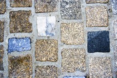 Cobbled tiled path texture. Cobbled tiled floor texture of marble and stone Royalty Free Stock Image