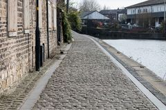 A Cobbled Towpath. Running alongside the Leeds Liverpool canal in Wigan Royalty Free Stock Photography