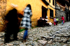Cobbled Turkish street. Rear view of people walking up cobbled street past colorful homes, Bursa city, Turkey Royalty Free Stock Photos