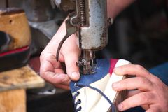 Cobbler. The master worker who repairs the shoe stock image