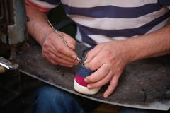 Cobbler. The master worker who repairs the shoe royalty free stock photo