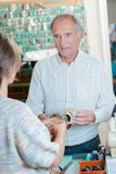 Cobbler conversing with customer. Casual royalty free stock photography
