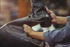 Cobbler making leather boots Royalty Free Stock Photos