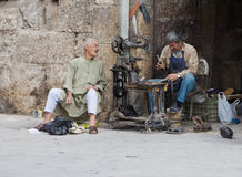 Cobbler outside Aleppo Citadel, Syria Stock Photo