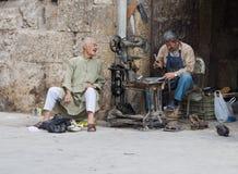 Cobbler outside Aleppo Citadel, Syria. A cobbler working outside the Aleppo Citadel, Syria stock photo