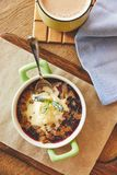 Cobbler pie dessert. Crumble served in pot with ice cream and coffee royalty free stock photography