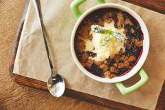 Cobbler pie dessert. Sweet crumble pie with berries and ice cream stock images