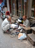Cobbler repairs shoes in walled city Lahore, Pakistan Royalty Free Stock Photography