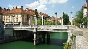 Ljubljana, Slovenia - 07/19/2015 - The Cobbler`s Bridge with Corinthian and Ionic pillars as lamp-bearers, sunny day. The Cobbler`s Bridge with Corinthian and stock photography