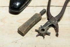Cobbler's Scene. Shoemakers' tools on Wooden Worktop Bench stock photo