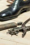 Cobbler's Scene. Shoemakers' tools on Wooden Worktop Bench stock images